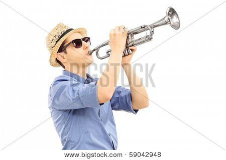 Young male musician playing trumpet isolated on white background