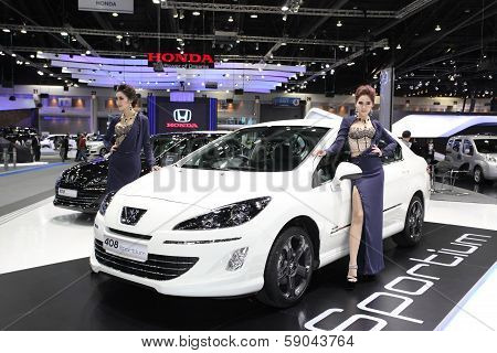 Nonthaburi - November 28: Peugeot 408 Sportium Car With Unidentified Models On Display At The 30Th T