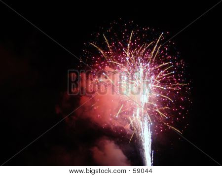 Firework Shooting Into The Night Sky