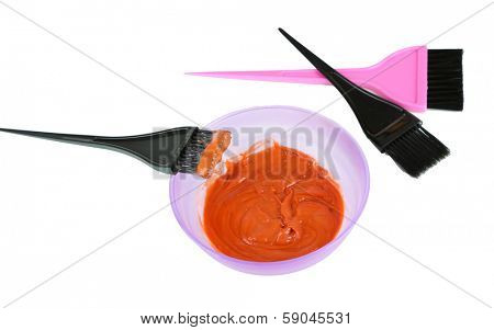 Bowl with hair dye and brush for hair coloring, isolated on white