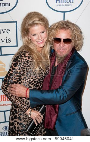 BEVERLY HILLS, CA. - JANUARY 25: Sammy Hagar & wife Kari arrive at the Clive Davis & The Recording Academy annual Pre-GRAMMY Gala on January 25th 2014 at the Beverly Hilton in Beverly Hills.