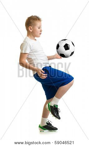 Boy kicking soccer ball by knee isolated on white. Training exercise.