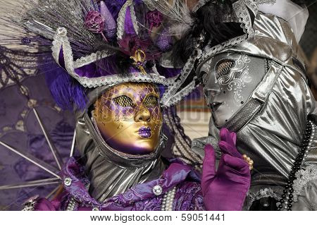 VENICE - FEBRUARY 28: Two unidentified people in costume in St. Mark's Square during the Carnival of Venice on February 28, 2011. The 2011 carnival is being held from February 26th to March 8th.