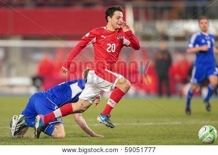 VIENNA,  AUSTRIA - MARCH 22 Philipp Hosiner (#20 Austria) runs with the ball during the world cup qualifier game on March 22, 2013 in Vienna, Austria.