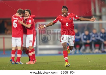 VIENNA,  AUSTRIA - MARCH 22 David Alaba (#8 Austria) celebrates a goal during the world cup qualifier game on March 22, 2013 in Vienna, Austria.