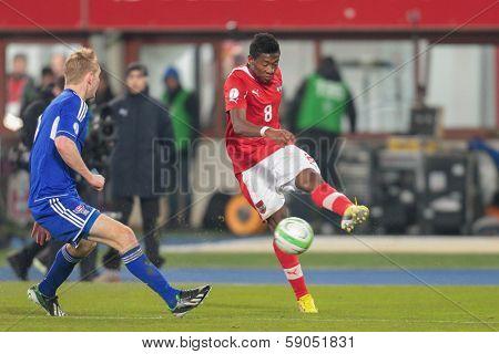 VIENNA,  AUSTRIA - MARCH 22 David Alaba (#8 Austria) kicks the ball during the world cup qualifier game on March 22, 2013 in Vienna, Austria.