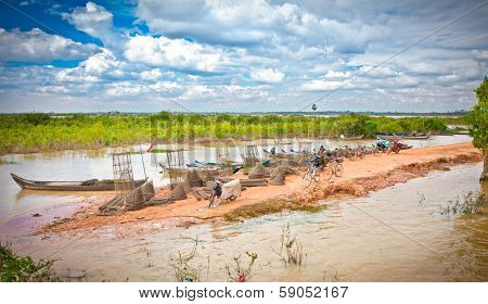SIEM REAP, CAMBODIA-NOV 22, 2013: Cambodian people live beside Tonle Sap Lake in Siem Reap, Cambodia on Nov 22, 2013. Tonle Sap is the largest freshwater lake in SE Asia peaking at 16k km2