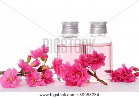 Two Bottle of massaging oil and Pink cherry