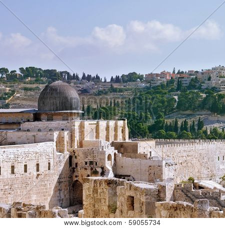 The walls of Jerusalem. In the distance you can see the gray dome of the Al-Aqsa Mosque and the Muslim minaret