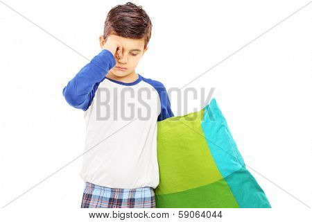 Sleepy kid holding a pillow isolated on white background