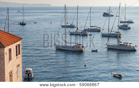 VIS, CROATIA - AUGUST 19, 2012: Yachts and boats in the harbour of Komiza on the island of Vis in Croatia.