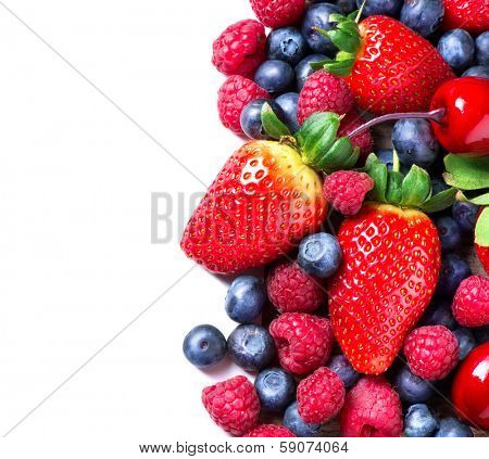 Berries border isolated on White Background. Summer or Spring Organic Berry closeup. Strawberries, Raspberries, Blueberry and Cherry. Agriculture, Gardening, Harvest Concept. Vitamin