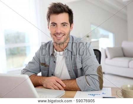 Man working from home with laptop