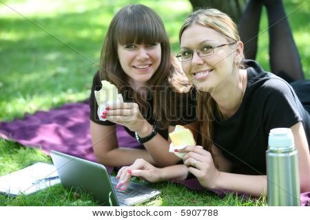 Two Young Businesswoman With Laptop