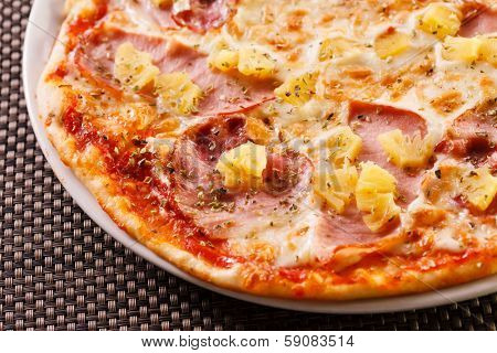 Pizza with pineapple and ham