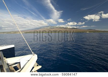 Front of a catamaran, Haleakala Mountain in background.Maui, Hawaii