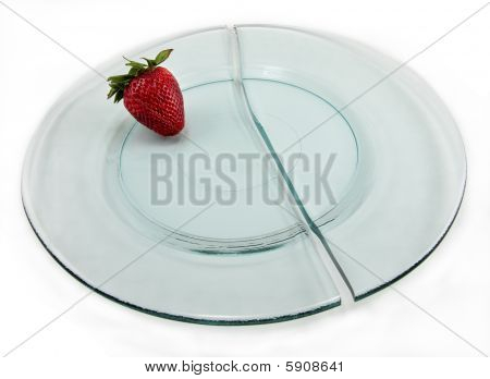 Broken plate with strawberry