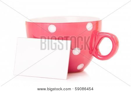 Big mug polka dot of tea and blank or empty paper with copyspace