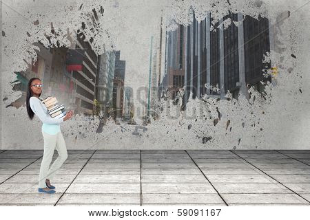 Side view of young woman carrying a pile of books against road turning into arrow