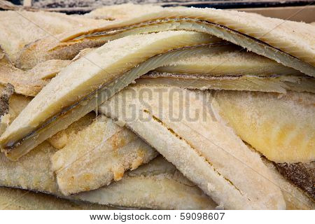 Cod fish salted codfish in a row stacked in market
