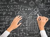 stock photo of formulas  - Hand writing science and math formulas on chalkboard - JPG