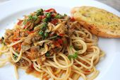 stock photo of clam  - Clams spaghetti spicy  Asian sauce Thai fusion dish - JPG