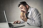 image of ironic  - eating in the office - JPG
