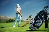 foto of golf bag  - Golf shot on course in fairway on vacation - JPG