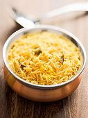 image of biryani  - close up of a bowl of indian golden biryani rice - JPG
