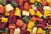 stock photo of pene  - Background image of colorful  italian pasta background - JPG