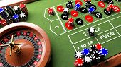 stock photo of roulette table  - Casino complete table with roulette and chips - JPG