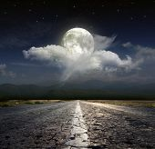 stock photo of paved road  - Paved road in the moonlight - JPG