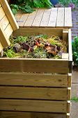 stock photo of garbage bin  - Compost bins made of wood for vegetable kitchen and garden waste - JPG