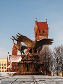 image of shadoof  - Sculpture depicting birds on the Red Church on Independence Square in Minsk - JPG