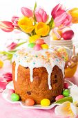 stock photo of easter candy  - Easter cake and  eggs on festive Easter table - JPG