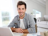 image of self-confident  - Man working from home with laptop - JPG