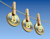 image of clotheslines  - Bitcoins  with wooden clothespin  - JPG