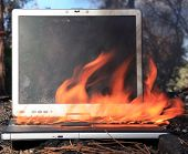 foto of lap  - A genuine Lap Top Computer completely engulfed in flames of fire - JPG
