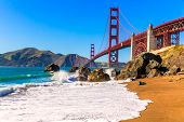 image of gate  - San Francisco Golden Gate Bridge GGB from Marshall beach in California USA - JPG