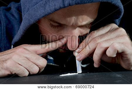 Sad Man Doing Sniffing Cocaine At Home On His Own