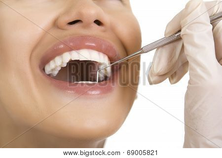 Close-up Of Female Patient Having Her Teeth Examined By Dentist