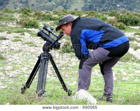 Cameraman Filming In Nature