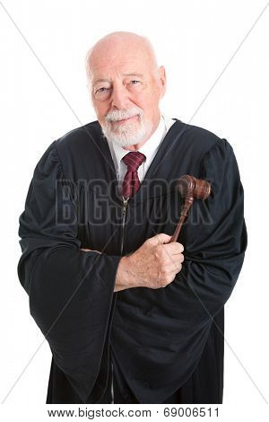 Mature friendly judge with gavel.  Isolated on white.