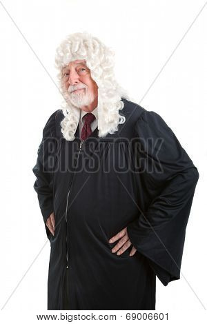 Serious looking judge wearing a wig.  Isolated on white.