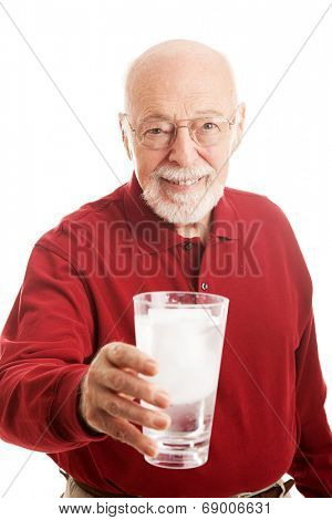 Senior man holding a glass of iced water.  Isolated on white.