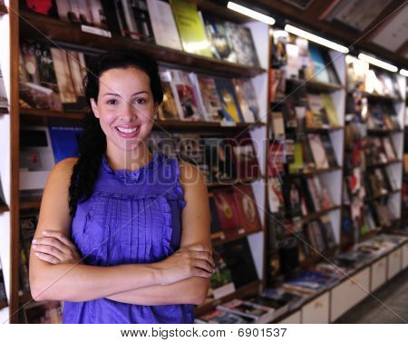 Happy Owner Of A Bookstore