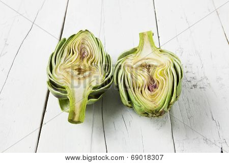 Artichoke Cut In Half On White Table