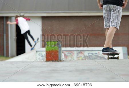 Two Skateboarders At Skatepark