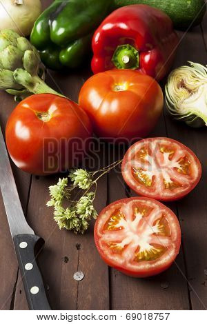 Tomatoes, Bell Peppers And Artichoke With Knife