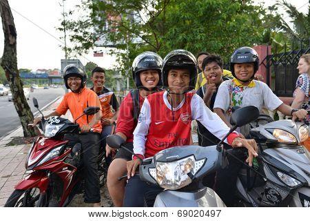 KUALA LUMPUR-APRIL 24: guys posing on motorbikes on April 24, 2014 in Kuala Lumpur, Malaysia. Motorbikes very popular for transportation in Asia